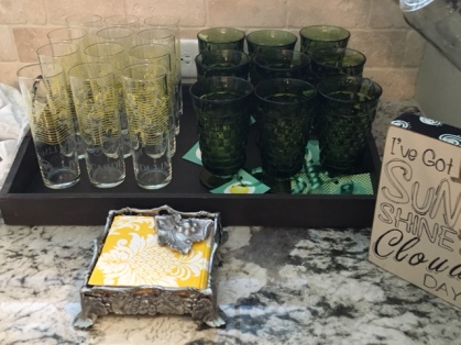 A collection of vintage glassware was used for the lemonade and mimosa bar.
