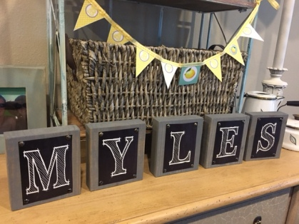 Baby's name was displayed on set of coordinating wooden blocks. A gift for the baby;s nursery after the party's over!