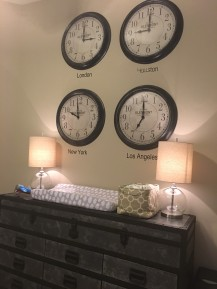 Time zone clocks are a nice budget-friendly option for a large art display. Dresser is industrial, metal and the trunk style is fitting with the travel theme.