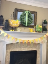 Mantle banner was made from free paint chip smaples form the local hardware store. Sunny accessories completed the mantle's look.