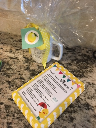 "Shower Game: Guests had fun playing a high-tech version of a scavenger hunt, using their smartphones. Prize was a ""You are my Sunshine"" mug filled with Lemonhead candy."