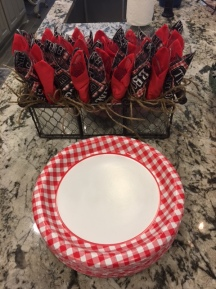 Casual and classic red and white gingham print enhances the backyard BBQ theme.