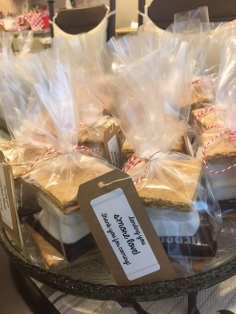 """Sending you s'more love"" favors. Send your guests home with their own s'more kit to make a special treat later!"
