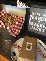 "A vintage ""Peanuts"" character playing baseball adorned the peanuts bags. A simple ""Peanuts and Cracker Jacks free printable was found online and made special in a frame."